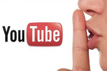 #PraCegoVer : Imagem de fundo branco com o logo do youtube na esquerda e na direita um rosto fazendo sinal de silêncio com o dedo na frente da boca.